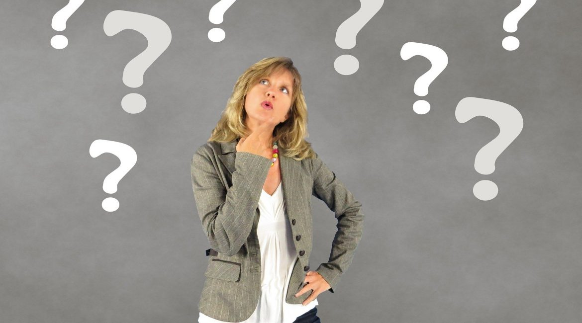 Photo of a woman with question marks